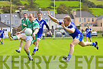 St Mary's man Aidan O'Sullivan cant get close enough to Milltown/Castlemaine's Jerome Fynn as he convert this chance into another score for the visitors.