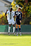 15 October 2008: University of New Hampshire Wildcats' midfielder Brad Hilton (right), a Freshman from Merrimack, NH, battles University of Vermont Catamount forward T.J. Gore, a Junior from Macomb, MI, at Centennial Field, in Burlington, Vermont. The Wildcats and Catamounts battled in overtime to a 0-0 tie...Mandatory Photo Credit: Ed Wolfstein Photo