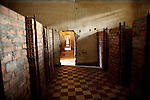 Other prisoners were kept in small brick cells like these while awaiting torture and execution.<br /> <br /> On 17th April 1975, after five years of civil war, Cambodia's capital Phnom Penh fell to the Khmer Rouge, who instigated a brutal reign of terror that would see the death of some 1.7 million Cambodians. In an attempt to create a self-sufficient agrarian paradise, cities were emptied, money and religion were banned and roughly a quarter of the population was worked and starved to death or executed. <br /> <br /> At the centre of this brutality was S-21, also known as Tuol Sleng, the Khmer Rouge prison located in the grounds of an old Phnom Penh school. Before the Vietnamese liberation of Phnom Penh on 7th January 1979, at least 14,000 people were tortured and executed here or at the nearby Choeung Ek killing field.