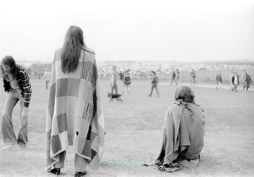 Revellers at Stonehenge  music festival on summer Solstice 1981.