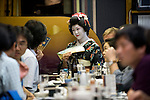 "Customers enjoy dinner and a chat with a geisha aboard a ""Yakata-bune"" pleasure boat run by Harumiya Co. in Tokyo, Japan on 30 August  2010. .Photographer: Robert Gilhooly"