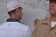 Bethesda, MD - June 29, 2014: Justin Rose signs the military wall of honor after winning the Quicken Loans National at the Congressional Country Club. The golf tournament raises money for the Tiger Woods Foundation.  (Photo by Don Baxter/Media Images International)