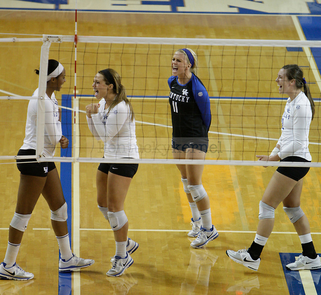 The team celebrates during the UK women's volleyball game v. Ohio University during the second round of the NCAA tournament in Memorial Coliseum in Lexington, Ky., on Saturday, December 1, 2012. Photo by Genevieve Adams | Staff