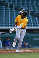 AZL Athletics Gold Marcus Smith (5) jogs to first base after being walked during an Arizona League game against the AZL Cubs 1 at Sloan Park on June 20, 2019 in Mesa, Arizona. AZL Athletics Gold defeated AZL Cubs 1 21-3. (Zachary Lucy/Four Seam Images)