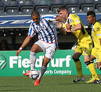 Josh Magennis being pressured by Jason Naismith in the Kilmarnock v St Mirren Scottish Professional Football League Premiership match played at Rugby Park, Kilmarnock on 13.9.14.