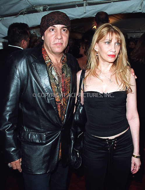 "Steven Van Zandt and wife attending a special screening of ""Road to Perditon"" to benefit the Association of the HITWG Camps and the International Rescue Committee. New York, July 9, 2002.  Please byline: Alecsey Boldeskul/NY Photo Press.   ..*PAY-PER-USE*      ....NY Photo Press:  ..phone (646) 267-6913;   ..e-mail: info@nyphotopress.com"