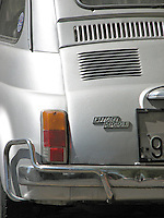 Back view of a metallic silver 1970's Fiat 500 L city car.