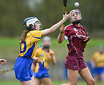 Evelyn Duggan of Clare in action against Caoimhe Garvey of Galway during their Minor A All-Ireland final at Nenagh.  Photograph by John Kelly.