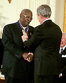 "Washington, D.C. - December 15, 2006 -- Riley ""B.B."" King  receives the Presidential Medal of Freedom  from United States President George W. Bush and first lady Laura Bush during a ceremony in the East Room of the White House on Friday, December 15, 2006.  The medal is the nation's highest civil award.  It may be awarded ""to any person who has made an especially meritorious contribution to (1) the security or national interests of the United States, or, (2) world peace, or (3) cultural or other significant public or private endeavors"".  One of the greatest blues singers and guitarists of all time, B.B. King is an American treasure.  For more than half a century, the ""King of the Blues"" and his guitar ""Lucille"" have thrilled audiences, influenced generations of guitarists, and helped give the blues its special place in the American musical tradition.  Raised in the Mississippi Delta, he began his career playing on street corners, and today has performed more than 10,000 shows, won 14 Grammys, and been inducted into the Rock and Roll Hall of Fame.  The United States honors B.B. King for his lifetime of achievement as one of America's greatest musicians.<br /> Credit: Ron Sachs / CNP"