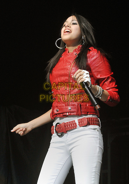 "JASMINE VILLEGAS.Teen R&B and pop singer JASMINE VILLEGAS performs as opening act to a SOLD OUT crowd at a stop on Justin Bieber's  ""MY WORLD TOUR 2010"" held at the Consol Energy Center, Pittsburgh, PA, USA..December 13th, 2010.stage concert live gig performance music half length white jeans denim red leather jacket belt.CAP/ADM/JN.©Jason L Nelson/AdMedia/Capital Pictures."