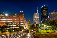 Took this on the bridge of the Sabine to Bagby pedestrian walkway as it crosses over the Buffalo bayou in downtown Houston with the high rise skyline in view.
