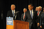 President Elect Barack Obama followed by Vice-President Elect Joseph Biden enters the first press conference of his transition team at the Hilton Hotel in downtown Chicago, Illinois on November 7, 2008.