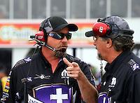 Apr 26, 2015; Baytown, TX, USA; John Medlen (right) co crew chief for NHRA funny car driver Jack Beckman during the Spring Nationals at Royal Purple Raceway. Mandatory Credit: Mark J. Rebilas-