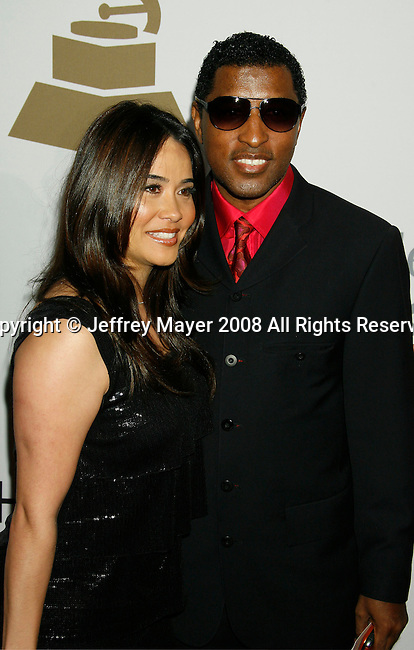 BEVERLY HILLS, CA. - February 07: Kenneth 'Babyface' 'Edmonds (R) and Nikki Pantenburg arrive at the 2009 GRAMMY Salute To Industry Icons honoring Clive Davis at the Beverly Hilton Hotel on February 7, 2009 in Beverly Hills, California.