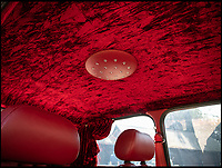 BNPS.co.uk (01202 558833)<br /> Pic: Silverstone/BNPS<br /> <br /> Glitter ball in the roof....<br /> <br /> Mini Bar - A 'funky' Mini Cooper that comes complete with its own disco ball and drinks bar is to be sold at auction by Jamiroquai singer Jay Kay.<br /> <br /> Affectionately nicknamed 'Chuckles' by the star, the Cooper Sport has been given a complete overhaul and is now completely unique.<br /> <br /> It has been fitted with plush velvet curtains and a bespoke red leather interior to go with a multicoloured disco light located on the cabin ceiling.
