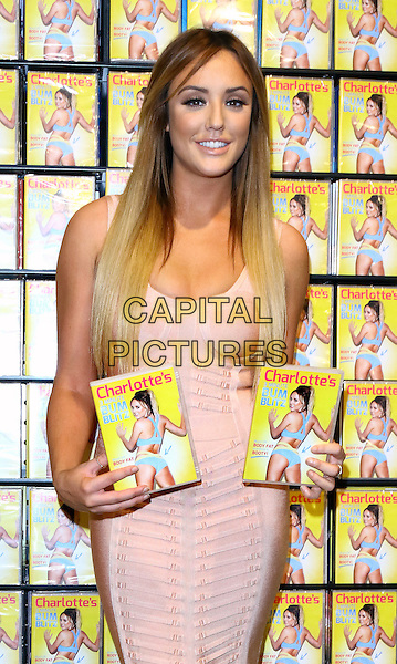 Charlotte Crosby signs copies of new fitness DVD 'Charlotte's 3 Minute Bum Blitz' at HMV Westfield, London on January 4th 2016<br /> CAP/ROS<br /> &copy;Steve Ross/Capital Pictures