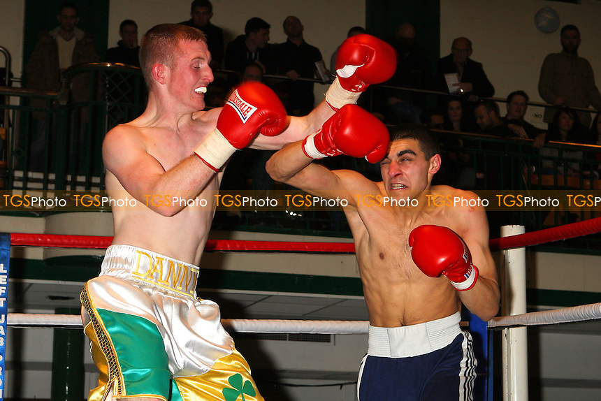 Danny Mulhern (white/green/gold shorts) defears Olafs Sirmanis in a Light-Middleweight boxing contest at York Hall, Bethnal Green, promoted by Left Jab - 04/03/11 - MANDATORY CREDIT: Gavin Ellis/TGSPHOTO - Self billing applies where appropriate - 0845 094 6026 - contact@tgsphoto.co.uk - NO UNPAID USE.