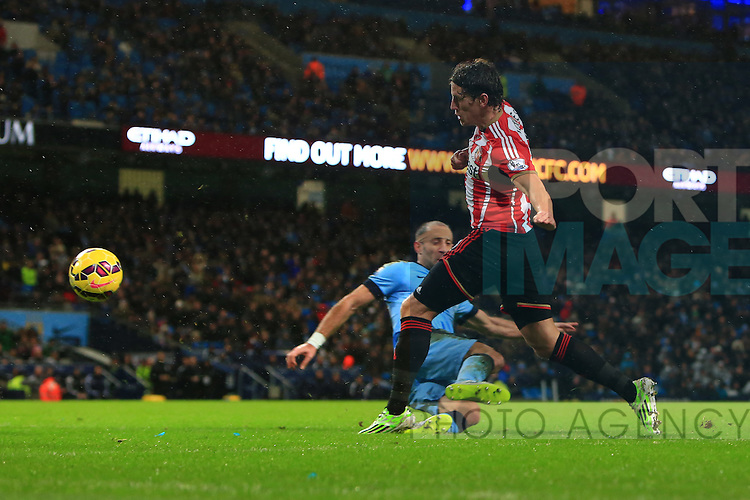 Pablo Zabaleta of Manchester City brings down Billy Jones of Sunderland to give away a penalty - Manchester City vs. Sunderland - Barclay's Premier League - Etihad Stadium - Manchester - 28/12/2014 Pic Philip Oldham/Sportimage