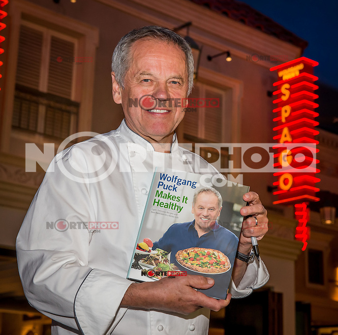 LAS VEGAS, NV - April 9 : Wolfgang Puck signs copies of, Wolfgang Puck Makes It Healthy: Light, Delicious Recipes and Easy Exercises for a Better Life, at Spago at Caesars Palace in Las Vegas, NV on April 9, 2014. Kabik/Starlitepics