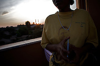 A waitress answers a call from a nearby table at the Obama Cafe In Amhara's regional capital Bahir Dar on President Barack Obama's inauguration day, Tuesday January 20 2009..