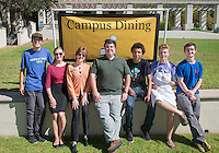 From left, FEAST President Dylan Bruce '16, Sustainability Coordinator Emma Sorrell '13, Associate VP for Hospitality Services Amy Munoz, Assistant Professor of Sociology, John Lang, Kai Foster '16, Carson Lambert '17 and Ben Clark '15 pose after announcing Occidental College's Real Food Challenge commitment during Good Food Day, part of Food Justice Month, sponsored by FEAST in the JSC quad on Oct. 24, 2014. The event featured free ice cream, free local apples and caramel, potted herbs and succulents, A taro pounding demonstration from the Hawaii Club, free local and organic food from the Green Truck and a Real Food Challenge commitment. (Photo by Marc Campos, Occidental College Photographer)