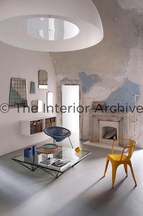 The living room is simply furnished and retains the distressed paint effect on the walls of the original convent