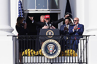 "Washington, DC - November 4, 2019: President Donald J. Trump embraces Kurt Suzuki, wearing a ""Make America Great Again"" hat, as the 2019 World Series Champion Washington Nationals are hosted at the White House, Nov 04, 2019. (Photo by Lenin Nolly/Media Images International)"