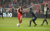 Chicago Fire midfielder Marco Pappa (16) squeezes past Philadelphia Union midfielder Keon Daniel (26).  The Chicago Fire defeated the Philadelphia Union 1-0 at Toyota Park in Bridgeview, IL on March 24, 2012.