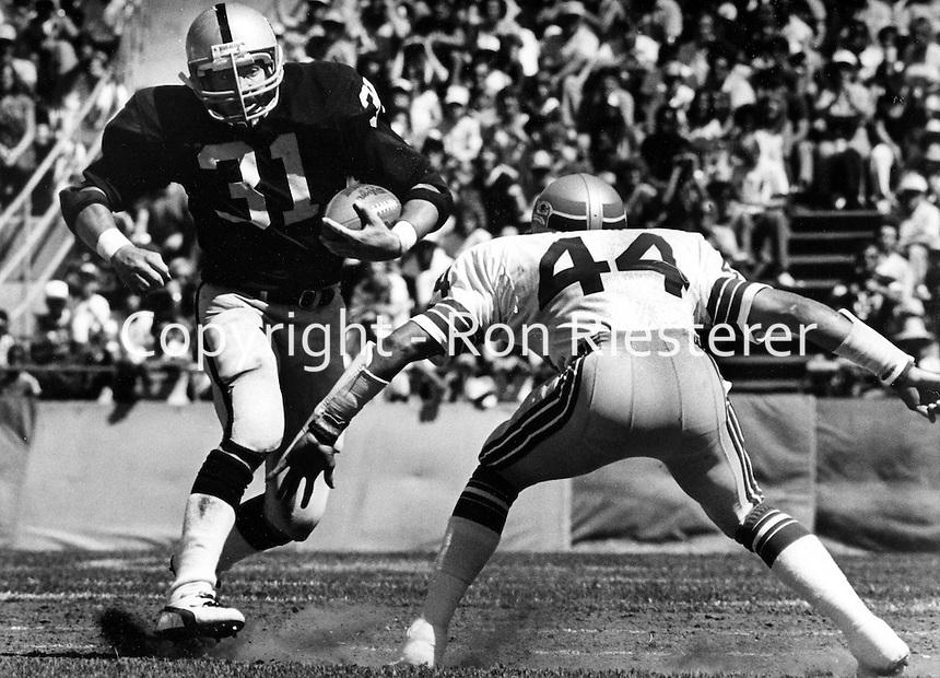 Oakland Raider running back Derrick Jenson runing against Seattle Seahawk John Harris. (1981 photo by Ron Riesterer)