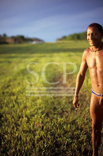 Xingu, Brazil. Pavuru; smiling Indian beside the landing strip.
