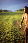 Xingu, Brazil. Pavuru; smiling Indian beside the landing strip.