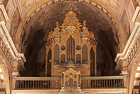 Organ, 17th century, in the nave of the Jesuit Church of Saints Justus and Pastor of Alcala, built 1575 on the site of a mosque in Granada, Andalusia, Southern Spain. The organ has been recently restored. Saints Justus and Pastor were 4th century schoolboy christian martyrs, who were killed for their faith under the persecution of the christians by the Roman emperor Diocletian. Granada was listed as a UNESCO World Heritage Site in 1984. Picture by Manuel Cohen