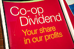 Co-op dividend profit share scheme advertised in shop window, East of England Co-operative Society, Suffolk, England