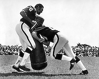 Oakland Raider training camp, in a exhibition for fans Jim Otto goes against Bob Brown in a battle of the linemen . (1971 photo by Ron Riesterer)