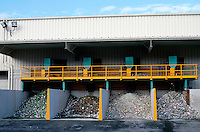 RECYCLING PLANT<br /> Sloatsburg, NY<br /> Aluminum cans placed into four piles for processing.