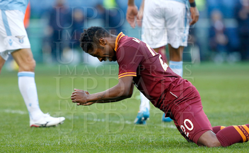 Calcio, Serie A: Lazio vs Roma. Roma, stadio Olimpico, 9 febbraio 2014.<br /> AS Roma midfielder Michel Bastos, of Brazil, reacts during the Italian Serie A football match between Lazio and AS Roma at Rome's Olympic stadium, 9 February 2014.<br /> UPDATE IMAGES PRESS/Riccardo De Luca