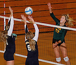 SPEARFISH, SD - NOVEMBER 1, 2013:  Meghan Sipe #12 of Black Hills State hits toward Colorado Christian blockers Summer Greager #21 and Ali Weber #5 during their game at the Donald E. Young Center in Spearfish, S.D. (Photo by Dick Carlson/Inertia)