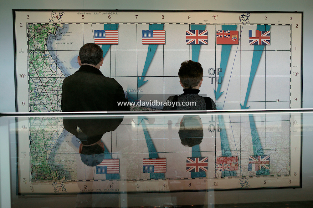 25 April 2004 - Arromanches, France - Visitors observe a map of the D-Day landings displayed in the Musee du Debarquement in Arromanches, France, 25 April 2004.