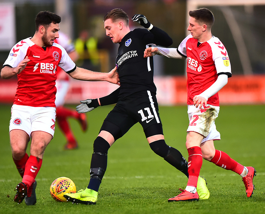 Portsmouth's Ronan Curtis competes with Fleetwood Town's Ashley Hunter and Lewis Coyle<br /> <br /> Photographer Richard Martin-Roberts/CameraSport<br /> <br /> The EFL Sky Bet League One - Fleetwood Town v Portsmouth - Saturday 29th December 2018 - Highbury Stadium - Fleetwood<br /> <br /> World Copyright © 2018 CameraSport. All rights reserved. 43 Linden Ave. Countesthorpe. Leicester. England. LE8 5PG - Tel: +44 (0) 116 277 4147 - admin@camerasport.com - www.camerasport.com