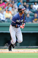 Third baseman Carlos Franco (11) of the Rome Braves in a game against the Greenville Drive on Friday, August 1, 2014, at Fluor Field at the West End in Greenville, South Carolina. Rome won, 5-1. (Tom Priddy/Four Seam Images)