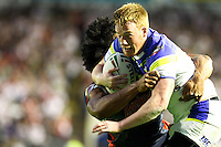 PICTURE BY ALEX WHITEHEAD/SWPIX.COM - Rugby League - Super League Play-Off - Warrington Wolves vs St Helens - The Halliwell Jones Stadium, Warrington, England - 15/09/12 - Warrington's Chris Riley is tackled by St Helens' Sia Soliola.