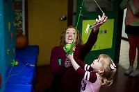 NWA Democrat-Gazette/CHARLIE KAIJO Jessica Butler of Fayetteville (center) plays a fishing game with Leah Butler, 2, Saturday, November 3, 2018 at the Helen Walton Children&Otilde;s Enrichment Center in Bentonville.<br />