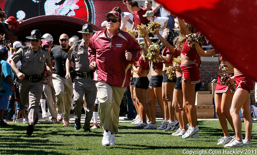 TALLAHASSEE, FLA. 4/16/11-FSUG&G041611 CH-Florida State Head Coach Jimbo Fisher takes the field for the Garnet Gold game Saturday in Tallahassee..COLIN HACKLEY PHOTO