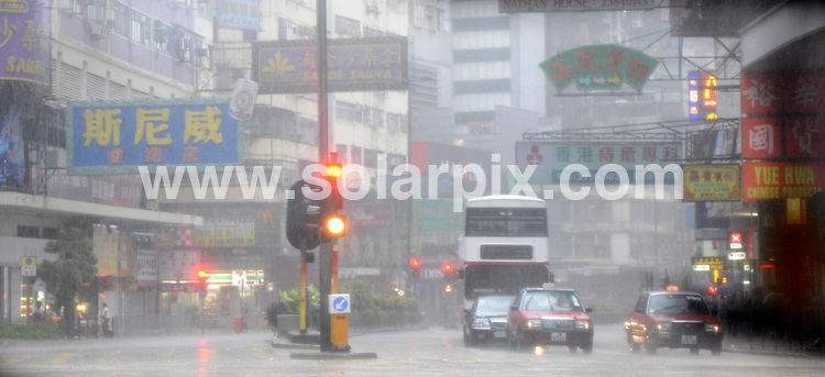 **ALL ROUND PICTURES FROM SOLARPIX.COM**.**SYNDICATION RIGHTS FOR UK AND SPAIN ONLY**.XXIX Olympic Games, 06 August 2008 in Hong Kong a man walks with an cardboard box holding over his head as Typhoon Kammuri crosses Hong Kong. .Schools and Kindergartens were closed. .Public transport is limited and At the Equestrian venue paper walls fell down and the lockers of the photographers too. .The Olympic Equestrian competitions will take place in Hong Kong in the capital of China..This pic:Public transport is limited..JOB REF:6976-CPR/David Hecker        DATE:06_08_08.**MUST CREDIT SOLARPIX.COM OR DOUBLE FEE WILL BE CHARGED* *UNDER NO CIRCUMSTANCES IS THIS IMAGE TO BE REPRODUCED FOR ANY ONLINE EDITION WITHOUT PRIOR PERMISSION*
