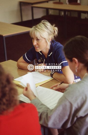 Nurse sitting at table undergoing staff development training at the Queens Medical Centre; Nottingham,