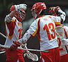Regan Quinn #13 of Chaminade gets congratulated by Will Renz #19, left, after scoring a goal to extend the Flyers' lead over Yorktown to 6-2 in the third quarter of a non-league varsity boys lacrosse game at Chaminade High School on Saturday, Apr. 23, 2016. Chaminade won by a score of 8-4.