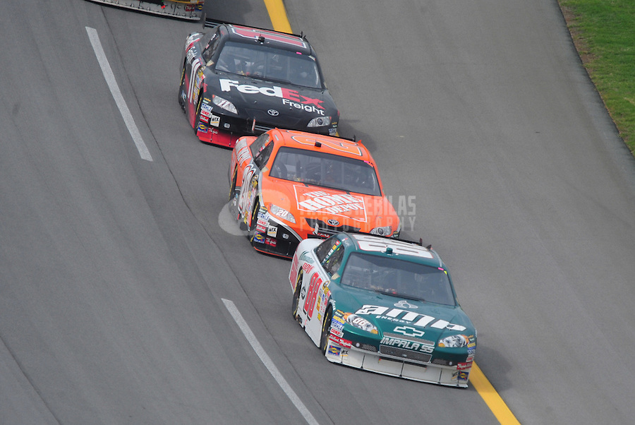 Apr 27, 2008; Talladega, AL, USA; NASCAR Sprint Cup Series driver Dale Earnhardt Jr (88) leads Tony Stewart (20) and Denny Hamlin (11) during the Aarons 499 at Talladega Superspeedway. Mandatory Credit: Mark J. Rebilas-