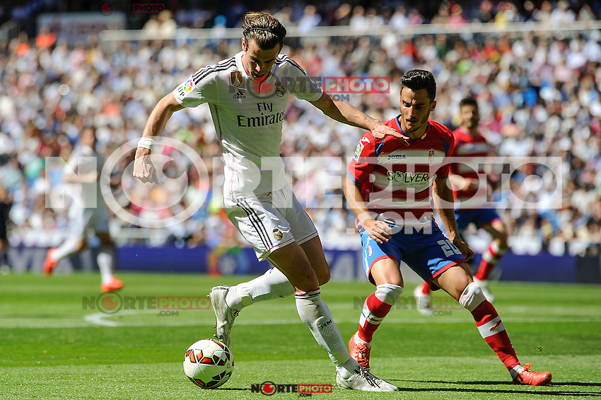 Real Madrid´s Gareth Bale and Granada´s Juan Carlos Perez during 2014-15 La Liga match between Real Madrid and Granada at Santiago Bernabeu stadium in Madrid, Spain. April 05, 2015. (ALTERPHOTOS/Luis Fernandez) /NORTEphoto.com