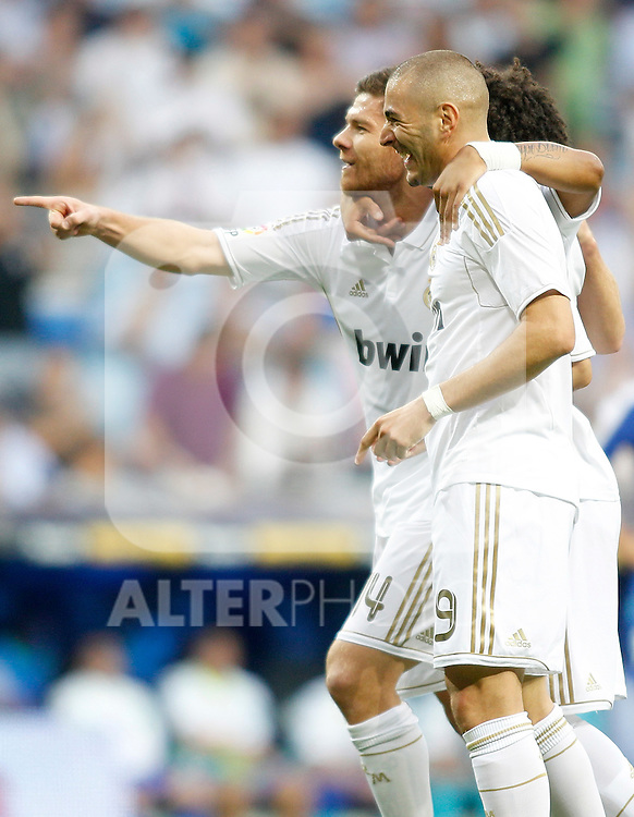 Real Madrid's Karim Benzema celebrates with Xabi Alonso during La Liga Match. September 10, 2011. (ALTERPHOTOS/Alvaro Hernandez)