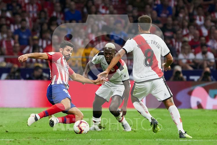 Atletico de Madrid's Diego Costa and Rayo Vallecano's Luis Advincula (c) and Oscar Guido Trejo during La Liga match. August 25, 2018. (ALTERPHOTOS/A. Perez Meca)